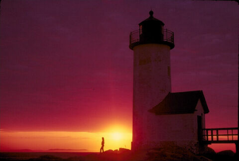 image of sunset by lighthouse
